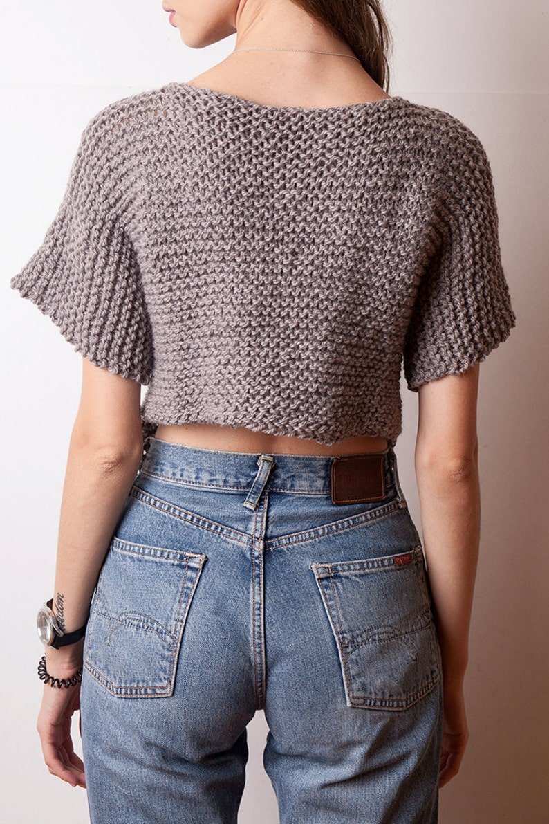 c4b0064642b Cable knit asymmetrical sweater short sleeved wool pullover