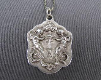 Vintage Gorham sterling silver cherub pendant