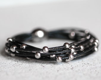 Black leather bracelet with silver beads.  Magnetic clasp /