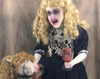 Claudia the porcelain horror doll