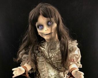 Death becomes her porcelain horror doll
