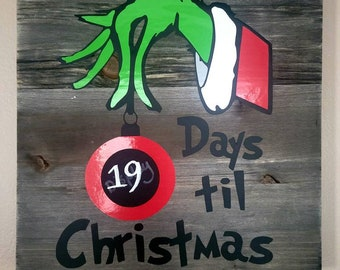 Christmas countdown hand holding ornament with chalk sticker and chalk marker included in gray