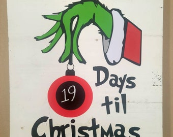 Christmas countdown hand holding ornament with chalk sticker and chalk marker included in white