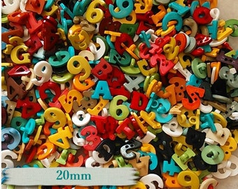30 buttons, 20m, Figures and Letters, plastic, assorted colors, 1-2-3-4-6-9-0-A-B-C-D-G-T, BF23