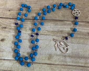 Blue lava rock eye of ra prayer beads, eye of Horus prayer beads, Egyptian paganism, pagan prayer beads, wiccan prayer beads, occult prayer