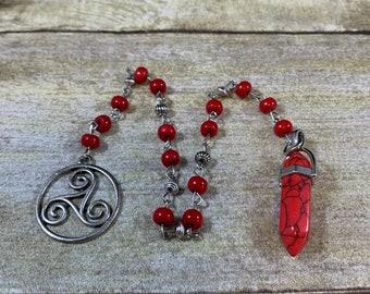 Red howlite and magnesite pendulum, triskelion pendulum, pagan pendulum, occult pendulum, wiccan pendulum, witchcraft pendulum