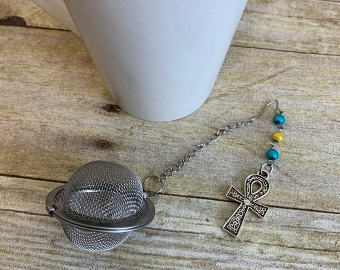 Featured listing image: Blue and yellow mirrored ankh tea diffuser, ankh tea infuser, pagan tea diffuser, pagan tea infuser, witch tea infuser, wiccan tea infuser