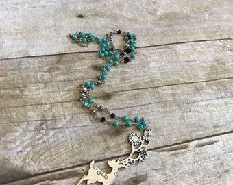 Blue and black flower deer necklace
