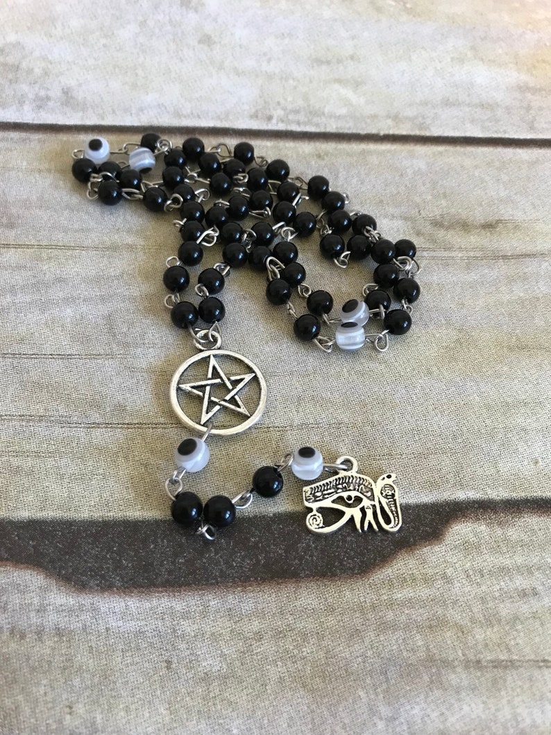 Black and white eye of ra rosary, eye of horus, protection amulet, pagan  rosary, pagan prayer beads, egyptian inspired, wiccan rosary