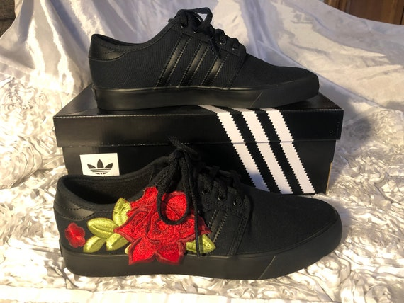 Black adidas skate shoes with red
