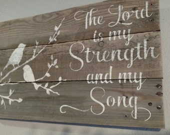The Lord is my Strength and Song pallet sign with birds on tree branch.