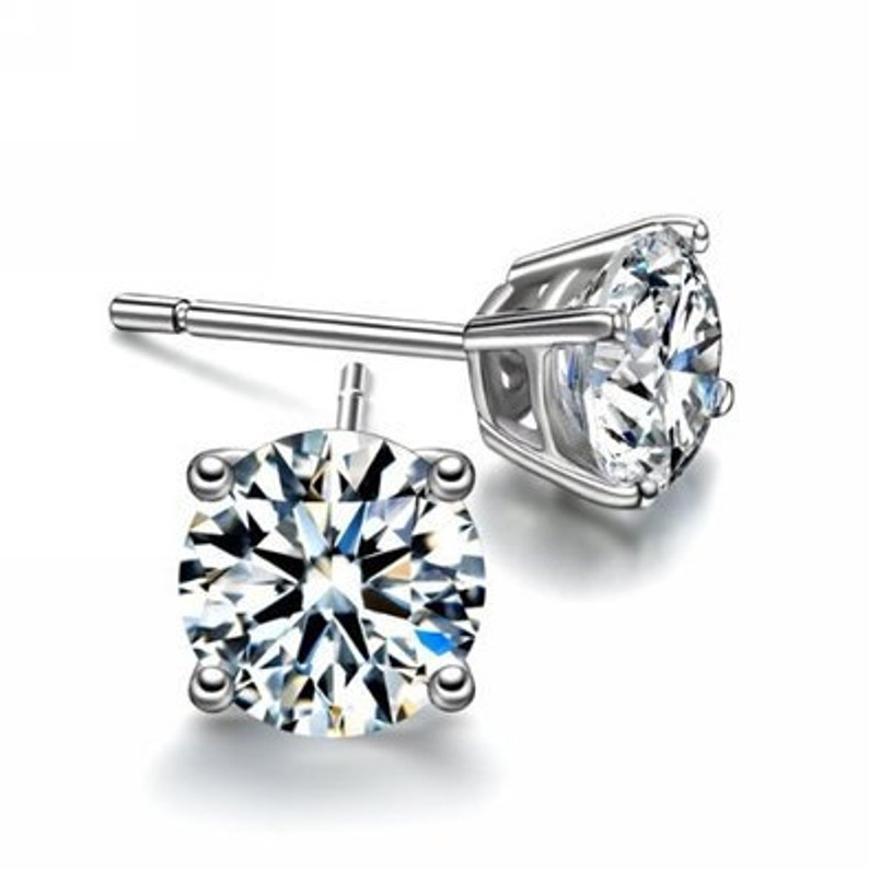 49f93cbbe17c0 Two Pair of CZ Diamond Studs