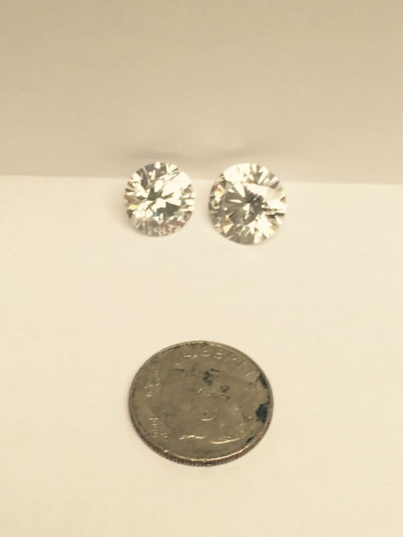 cb6c269e5aa28 Amazing CZ Diamond Studs 4 Carats each plus a F R E E pair of one carat  studs