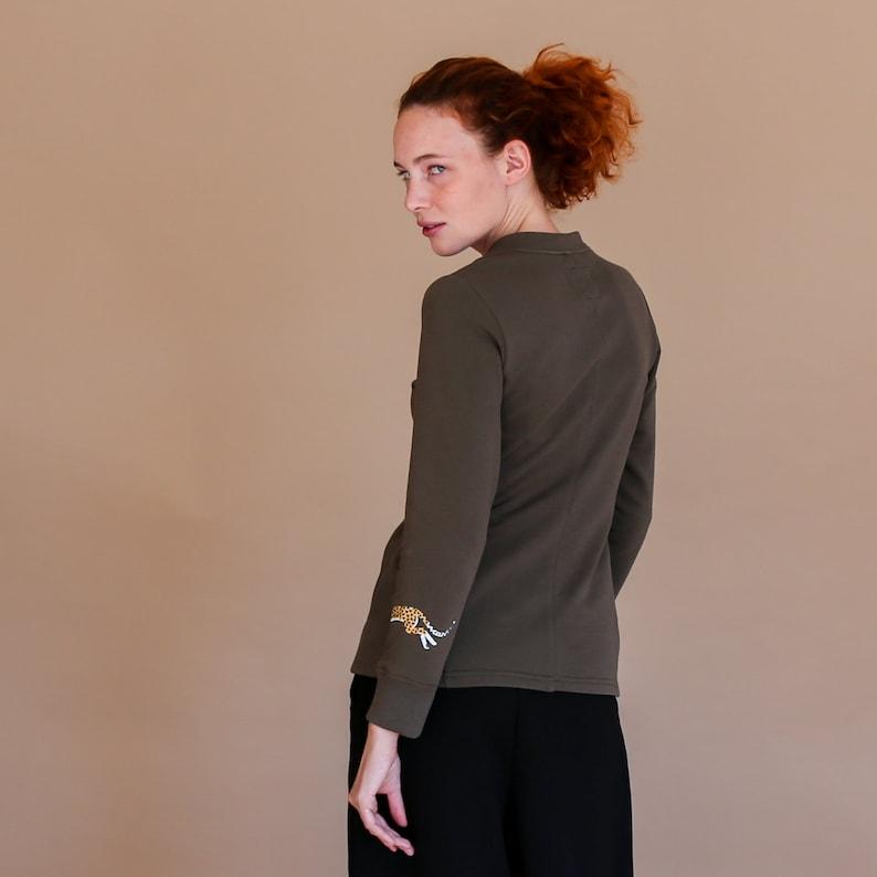 tatoo designed print Slow fashion khaki sweatshirt of v neck style with animal printed bracelet light sping apparel grunge sweater
