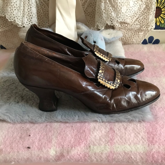 Antique Edwardian brown leather shoes with a brass