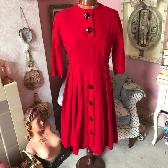 1940s red wool dress with large black glass button