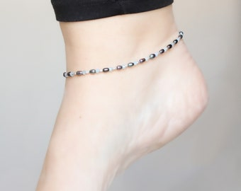 Handmade pearl and aquamarine anklet with beautiful faceted aquamarine teardrop & silver feather charms