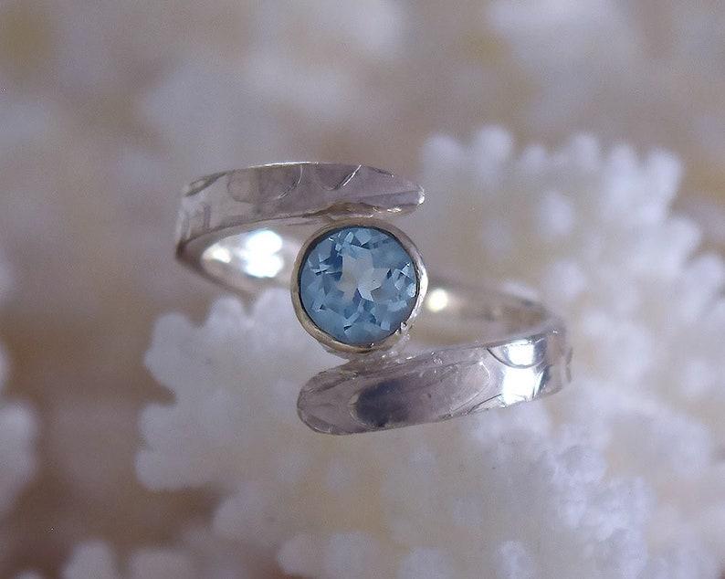 Aquamarine engagement cross over ring