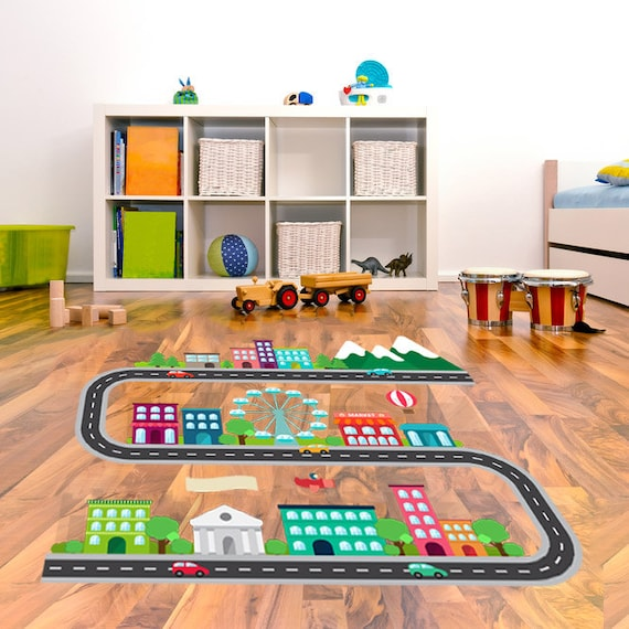 Kids race car track floor decals in a city scape design