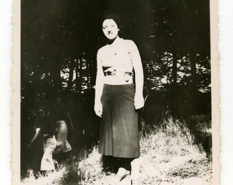 Vintage photo 'Step into the light' vernacular photography snasphot, high contrast lady in the forest, outdoors