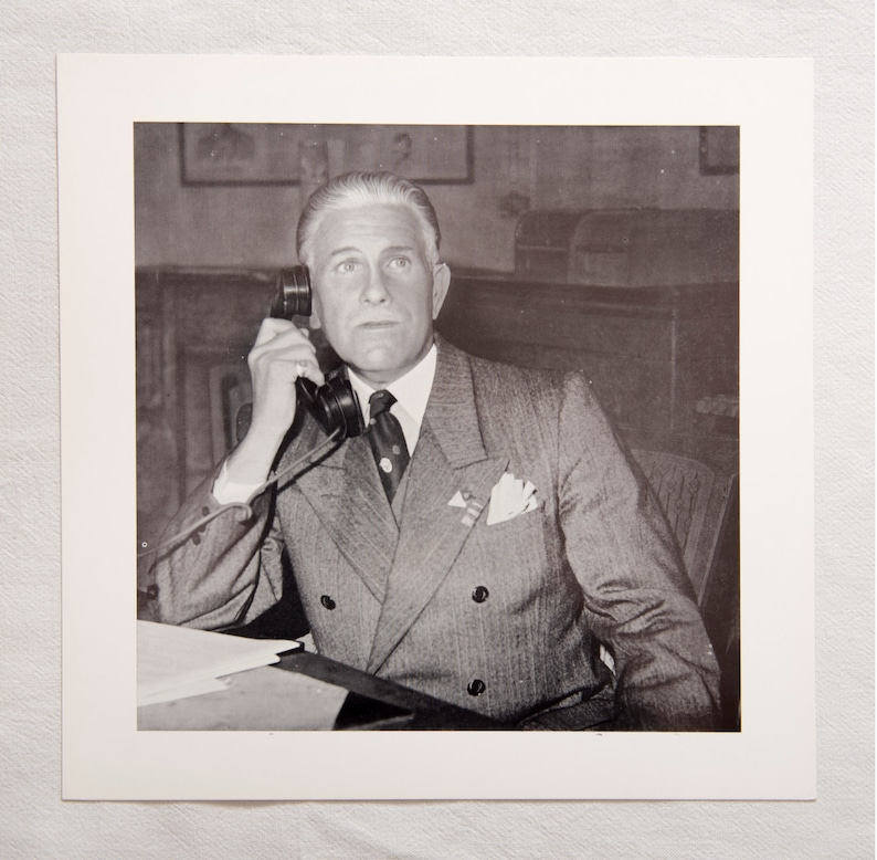 portrait of a man sharply dressed in a suit with telephone The call vintage lithographic photo print