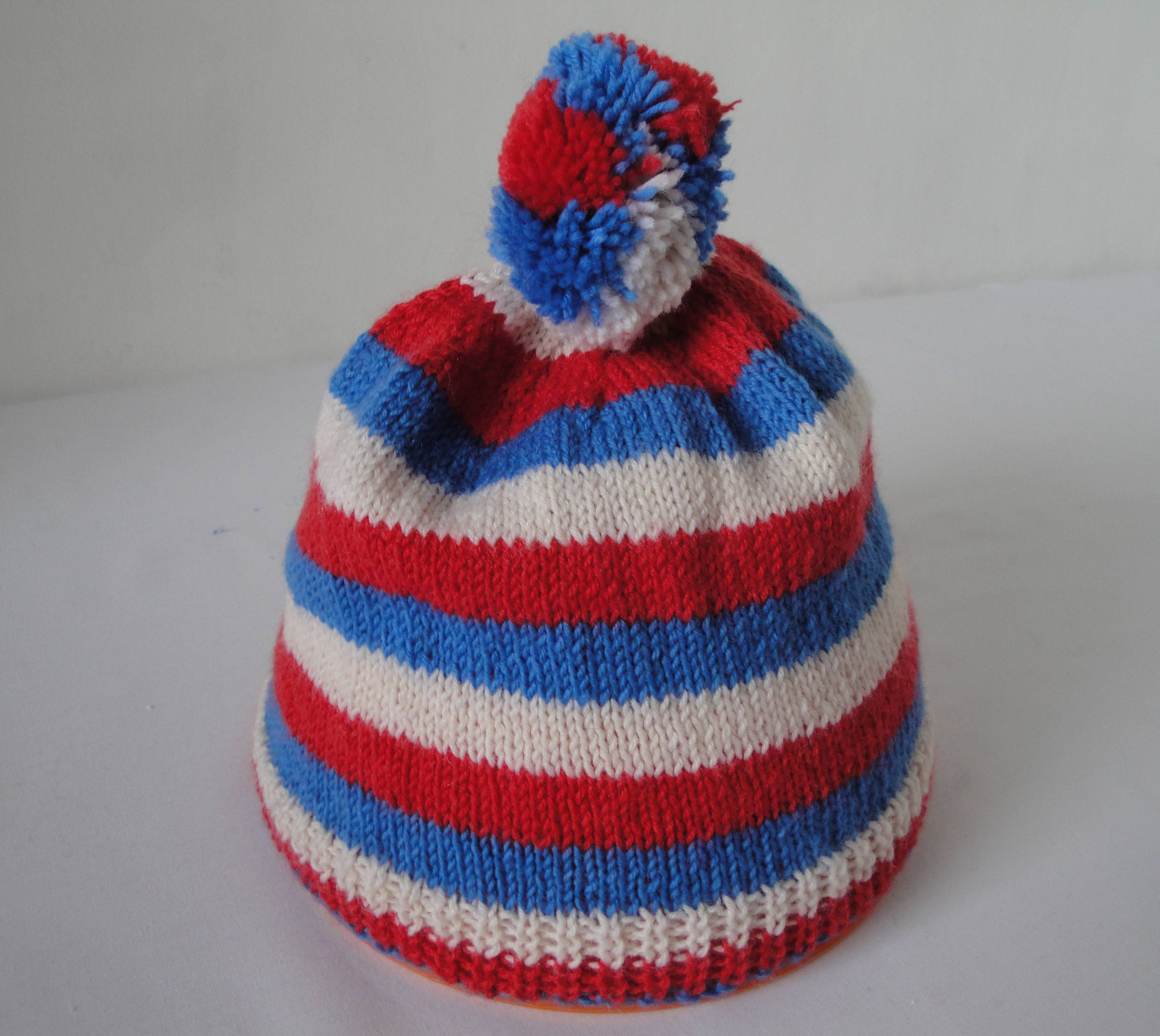 6d128ba72cc Childs bobble hat red white and blue stripe cap knit in
