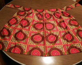 Sycodelic '60's homemade vintage apron. Red, brown, blue, and turquoise, on a yellow background. Circle, squares and paisleys