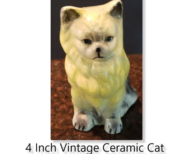 Vintage Four Inch Yellow Black White Ceramic Cat Figurine