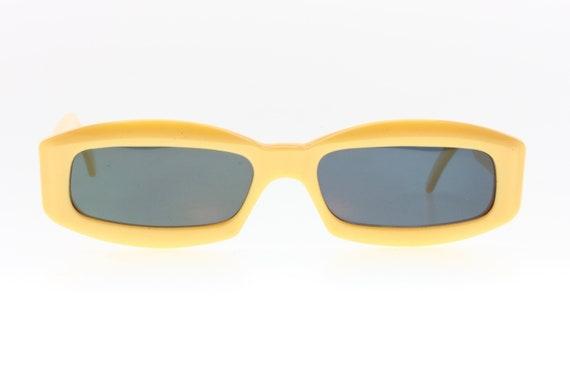 Twiggy style sunglasses. Seventies Mod. Flashy yel