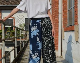 Bermuda cropped pants flower print. Plissé on one side. Super particular.