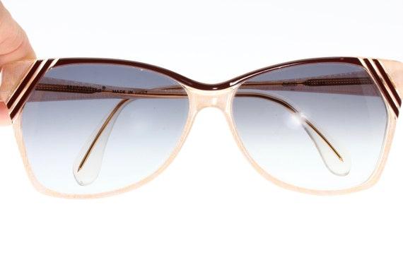 Seventies style vintage sunglasses. Powder pink co
