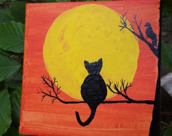 Kitty and crow in moonlight