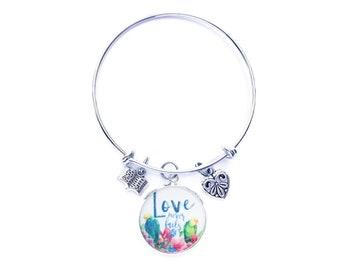 Love Never Fails Tropical Birds Bracelet | JW Gifts | International Convention | JW Jewelry | Jw.org