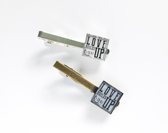 Love Builds Up Assembly Tie Clip