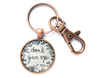 Don't Give Up Keychain