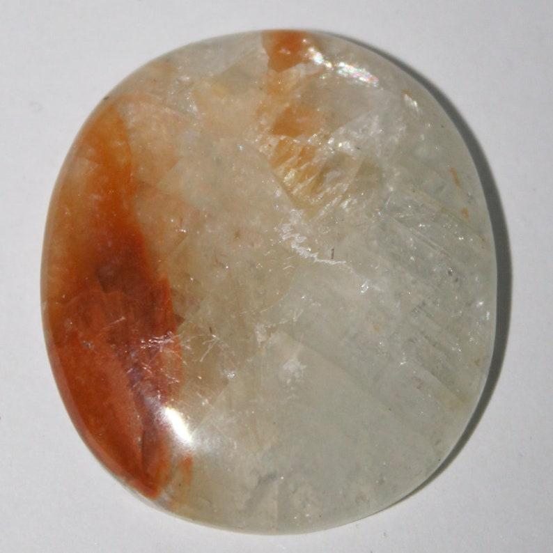 Orange calcite cabochon 36x32x4 mm