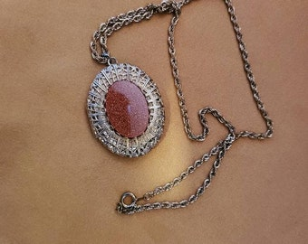Locket with sparkly stone