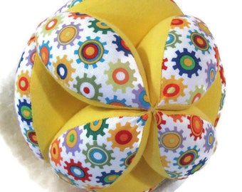 Gears yellow baby clutch ball, Amish puzzle ball, Montessori sensory toy, American made Tummy Time toy