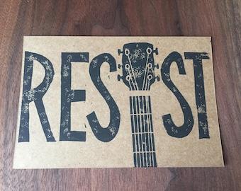 Resist Guitar postcard, hand printed linocut block print, 4 x 6