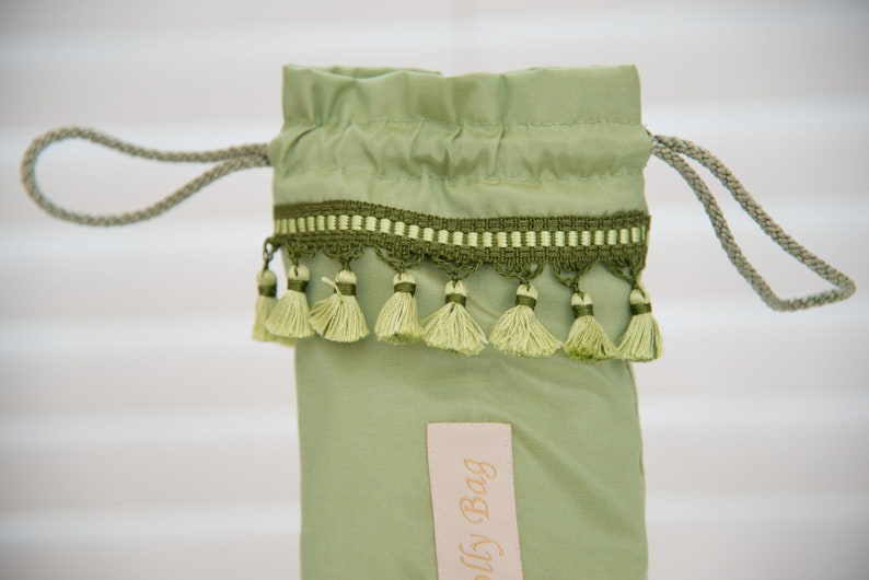Pretty Mint Green Satin with Mint Green Tassel trim detail umbrellabrolly bag