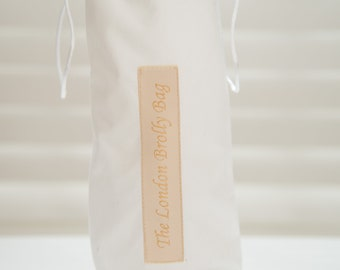 Stunning White  Cotton  with white toile braid trimUmbrella/ brolly bag