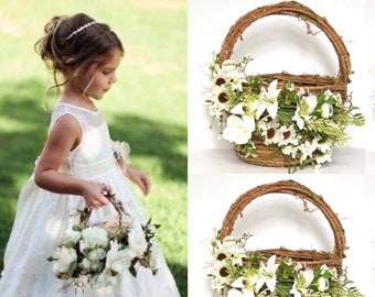 Flower girl basket with White flowers and greenery
