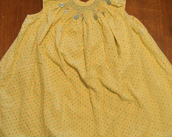 Light yellow bicycle design smocked dress for sizes 1, 2, 3, and 4