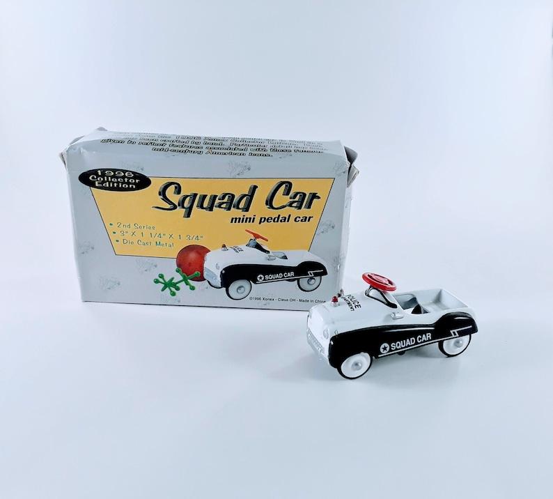 Xonex Black and White Squad Car Mini Pedal Car 1996 Collector image 0