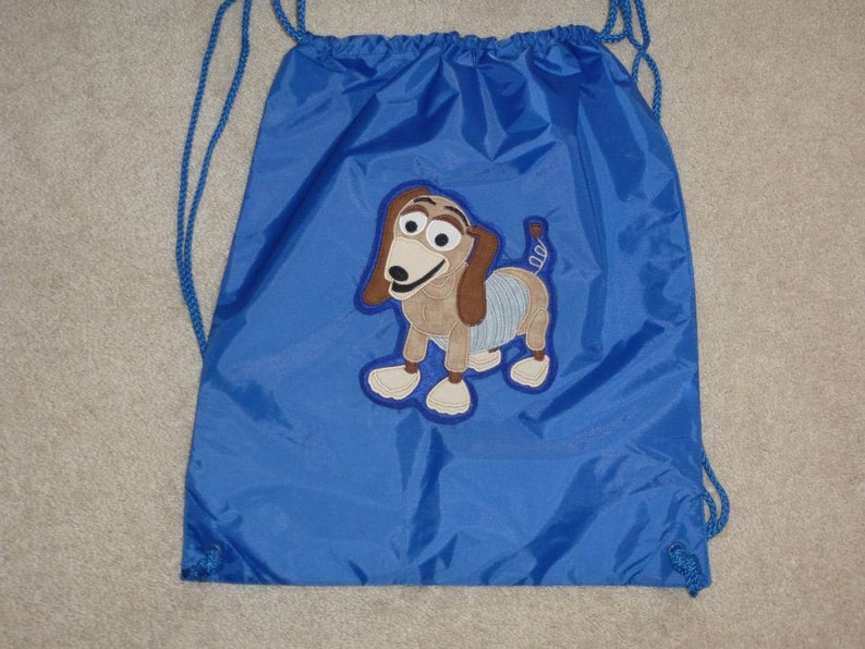 354493b10de SLINKY DoG from ToY SToRY Land Custom Boutique BAG String