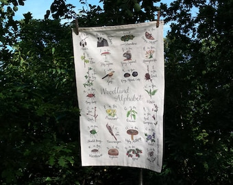 Alphabet Tea Towel of Woodland flora and fauna Illustrated by Alice Draws The Line, an A-Z of Woodland species with hand lettered labels