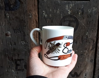 Bushcraft China Mug with illustrations by Alice Draws The Line. Tools and resources that a bushcraft fan might find useful