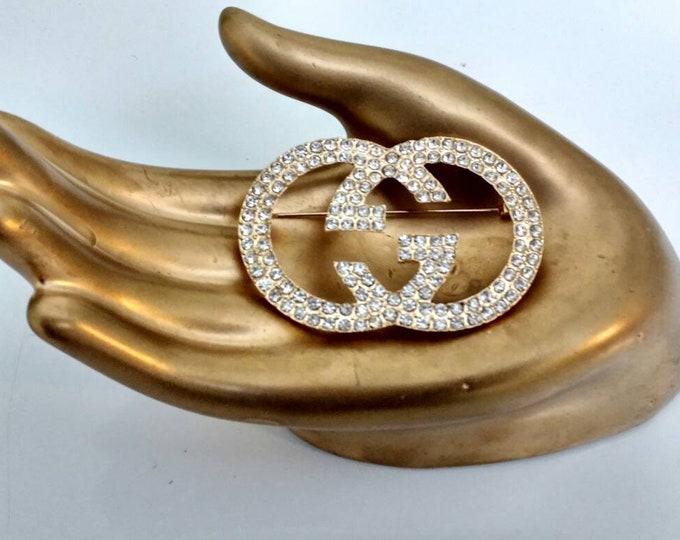 Designer Inspired Ladies Gold Rhinestone Brooch.