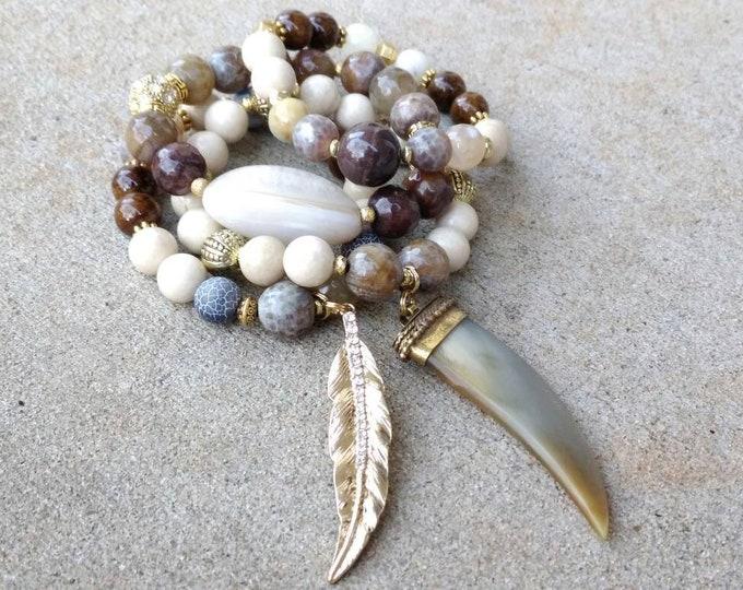 Boho Chic Gemstone horn and gold leaf Bracelet Stack of 4. Brown and cream beaded bracelet.