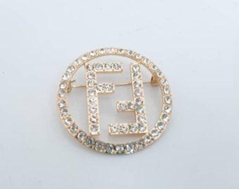 "Designer Inspired Ladies Gold Double ""F"" Rhinestone Brooch."